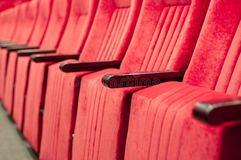 Empty assembly hall with red chairs in rows. concept of trainings, business meetings and conferences. For decor and design background texture stock photo