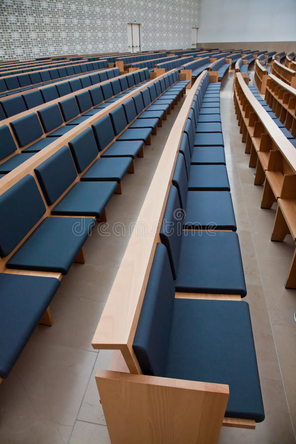 Empty Auditorium. Photo of an empty auditorium with blue seats stock images