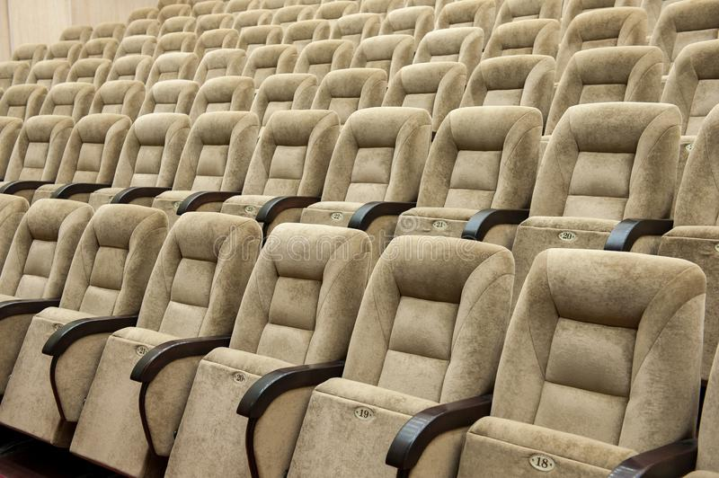 Empty auditorium with beige chairs, theatre or conference hall stock images