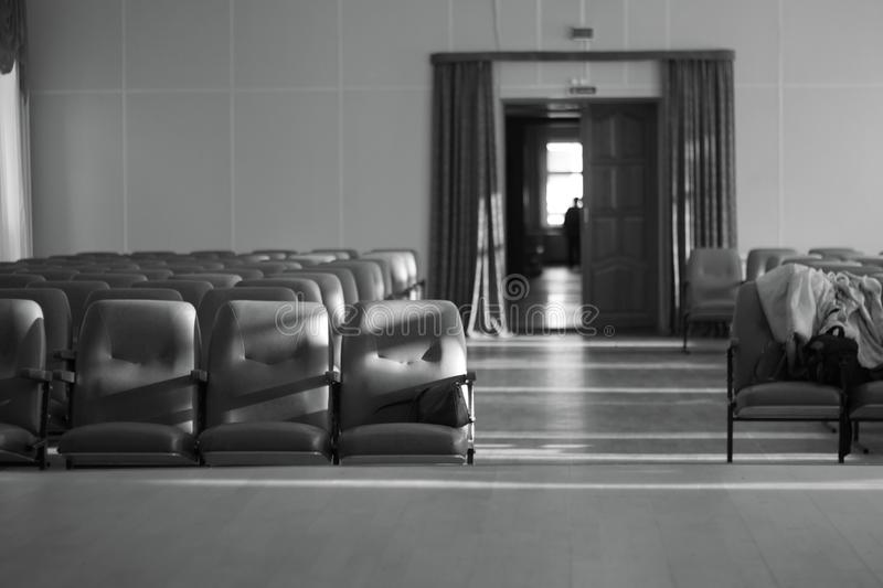 Empty auditorium with beige chairs, theatre or conference hall Black and white photo . stock photo