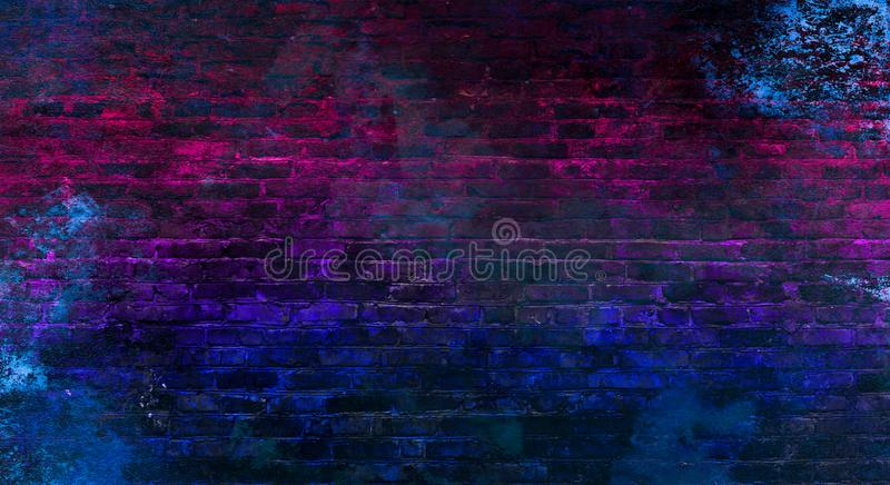Empty background of old brick wall, background, neon light. Background of an empty room with a brick wall, searchlight lights, neon light. Dark street, smoke royalty free stock image
