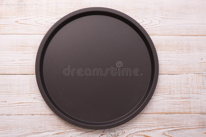 Empty baking tray for pizza on wooden table top view square. royalty free stock images