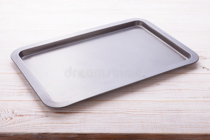 Empty baking tray on white wooden desk royalty free stock image