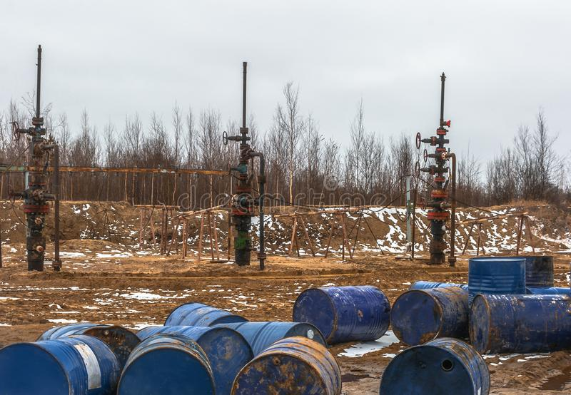 The oil is over. There is nothing to fill barrels. Empty barrels from the oil before the stopped oil wells. Ecological problem in the field royalty free stock photo