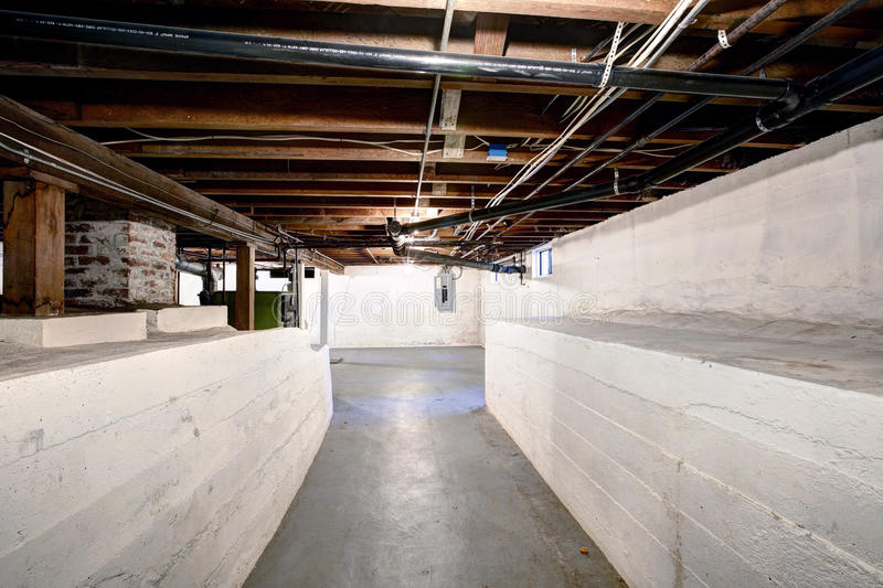 Empty basement in old house with white walls stock photography