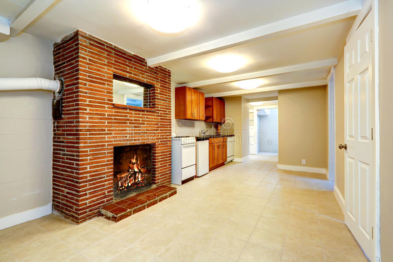 Empty basement room with brick fireplace royalty free stock photos