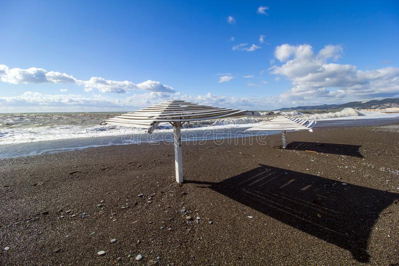 Empty beach of the Black sea. With sun loungers on a sunny day stock image