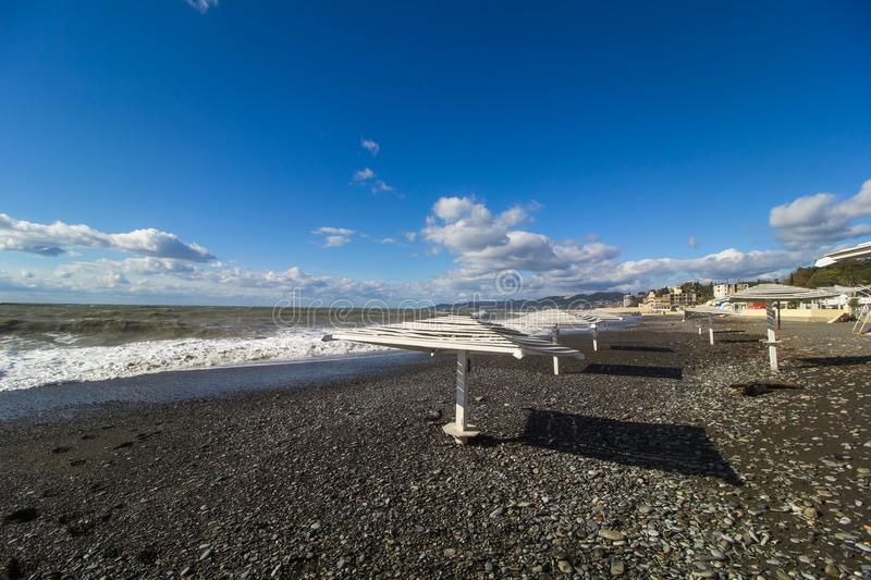 Empty beach of the Black sea. With sun loungers on a sunny day royalty free stock photo