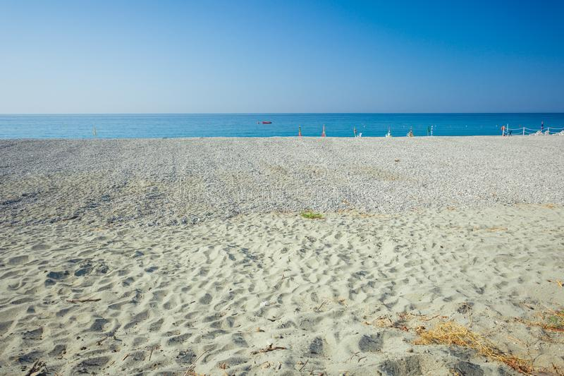 Empty beach in Calabria southern Italy. Concept of space and minimalism royalty free stock image