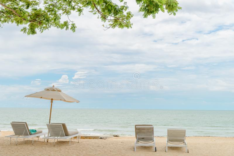Empty beach chairs on a beautiful beach at sunny day - vacation in summer time.  royalty free stock images