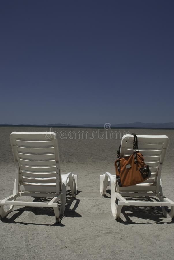 Empty Beach Chairs. Empty chairs at a beach in Puntarenas, Costa Rica royalty free stock images