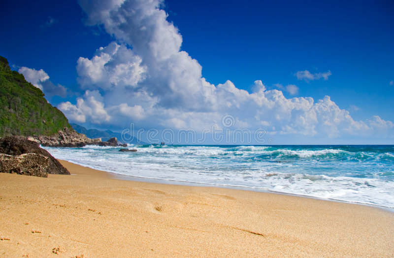 Empty beach with clouds royalty free stock photography