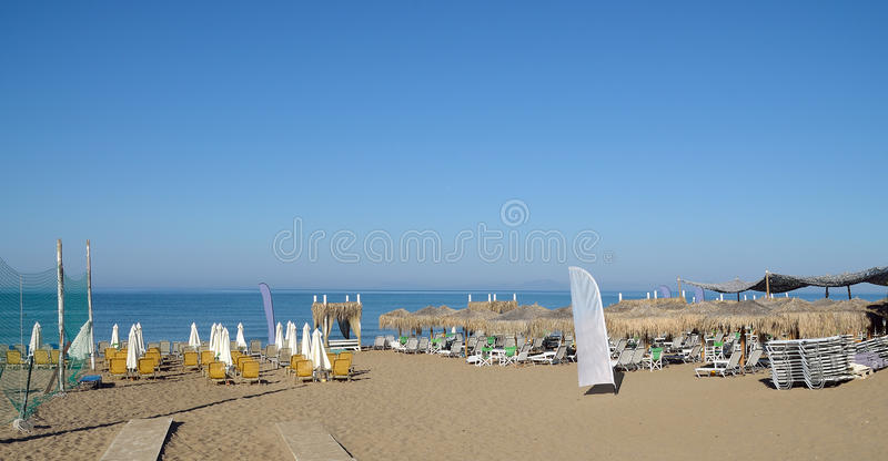 Empty beach. With deckchairs and sunshade umbrellas royalty free stock photo