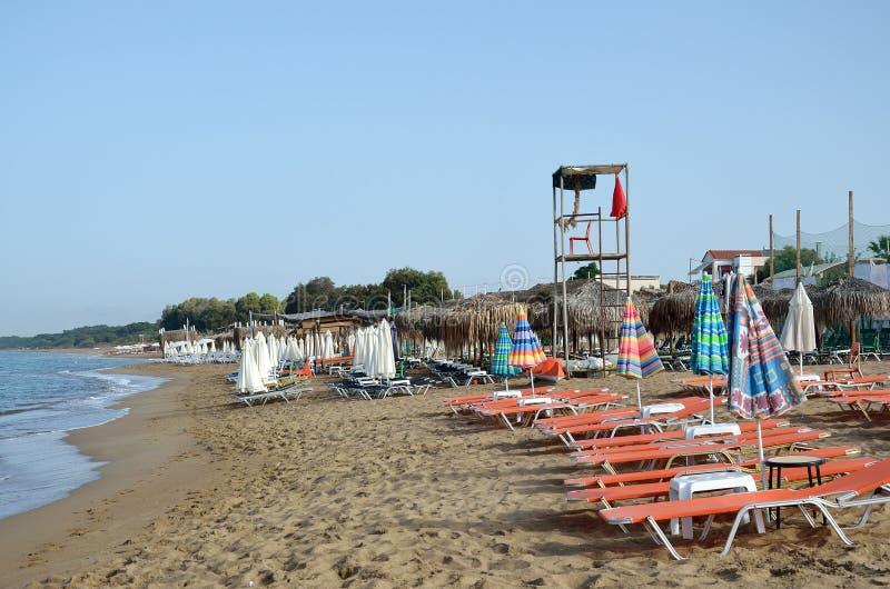Empty beach. With deckchairs and sunshade umbrellas and lifeguard tower in Kourouta, Amaliada Greece stock photos