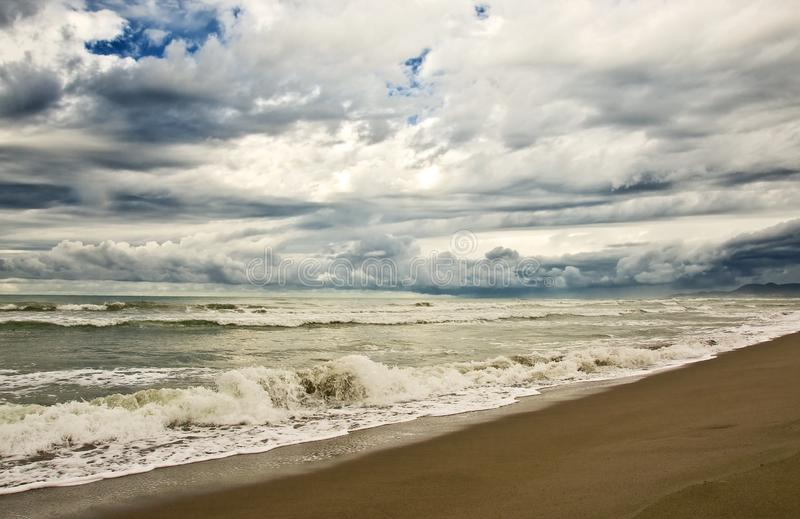 Empty beach duiring a storm with heavy clouds stock photography
