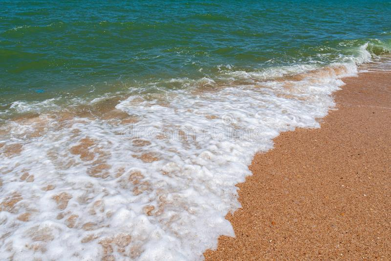 Empty beach with golden sand and azure water. Scenery stock images