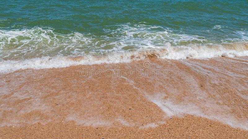 Empty beach with golden sand and azure water. Scenery stock photo