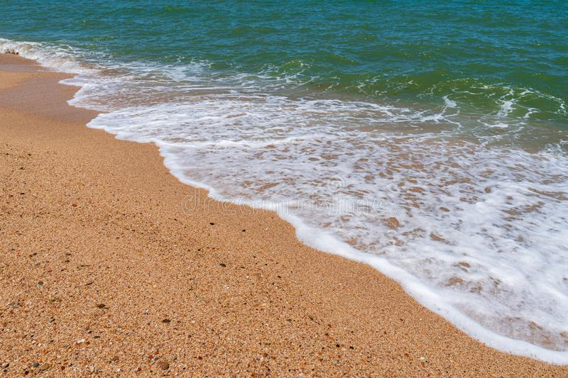 Empty beach with golden sand and azure water. Scenery royalty free stock image