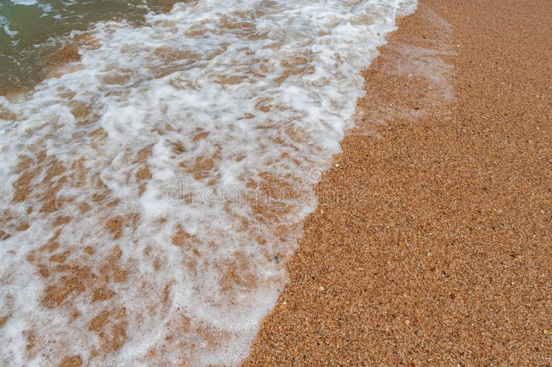 Empty beach with golden sand and azure water. Scenery royalty free stock photos