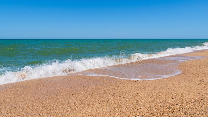 Empty beach with golden sand and azure water. Scene stock photography