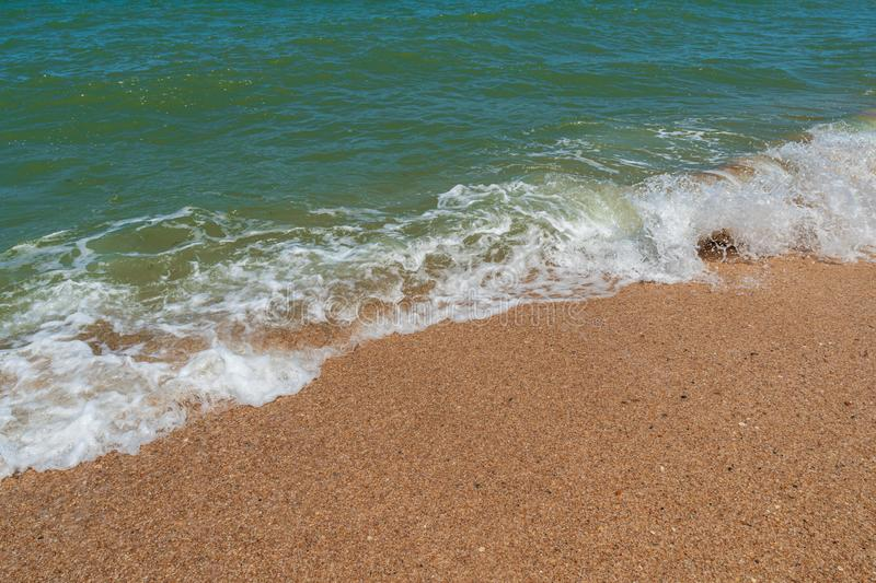 Empty beach with golden sand and azure water. Scenery royalty free stock photo