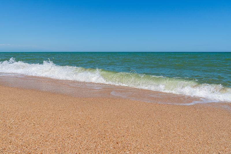 Empty beach with golden sand and azure water. Scene stock photos