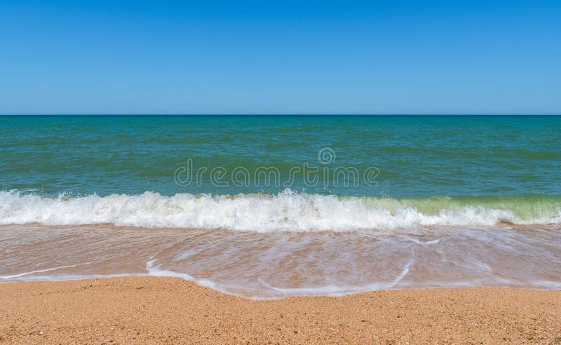 Empty beach with golden sand and azure water. Scene royalty free stock photos