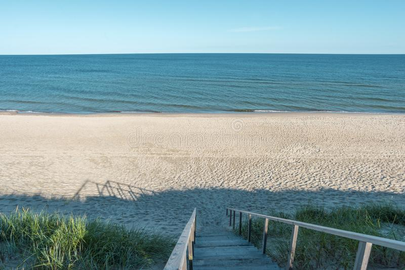 Empty beach landscape. With wooden stairs going down stock image