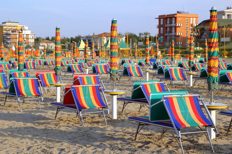 The empty beach with a lot of sunbeds and umbrellas. Travel to Rimini, Italy. The empty beach with a lot of sunbeds and umbrellas stock photography