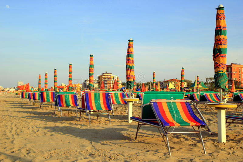 The empty beach with a lot of sunbeds and umbrellas. Travel to Rimini, Italy. The empty beach with a lot of sunbeds and umbrellas stock images