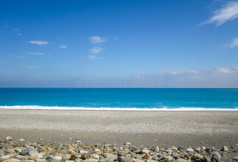 Empty beach of pacific ocean in Hualian, Taiwan. Empty beach of pacific ocean in Hualian or Hualien, Taiwan under summer sunlight with sand and marbles royalty free stock photos