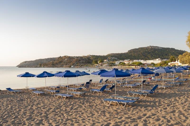Empty beach on Rhodes island, Greece. Empty morning beach on Rhodes island, Faliraki village, Greece stock image