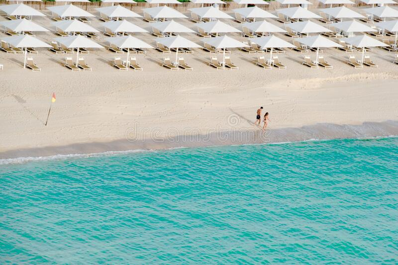 Empty beach on turquoise clear Indian Ocean water in Dubai. Life stock photography