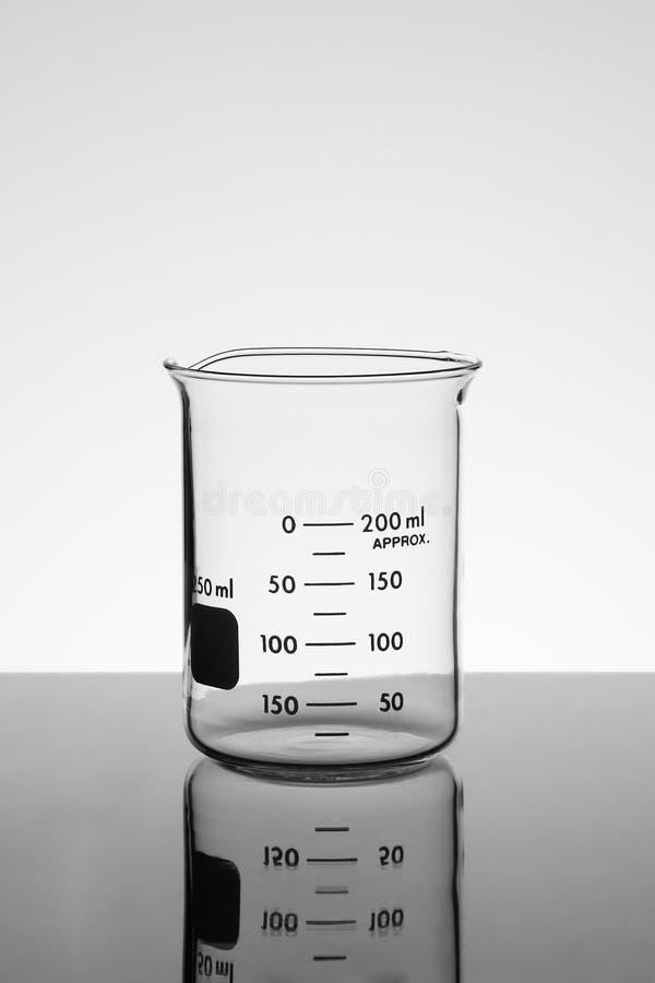 Empty Beaker on Table stock photos