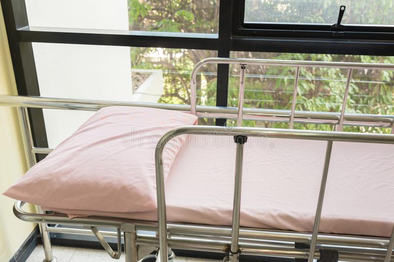 Empty bed in the hospital Emergency department . Deluxe private ward. equipped hospital room. image for illustration, article,. Copy space.Medical Benefits stock image