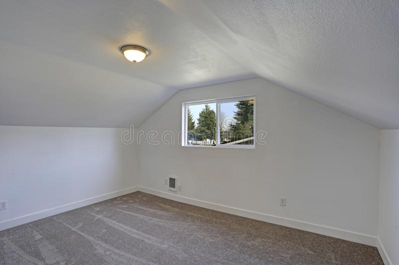 Empty bedroom interior with vaulted ceiling on the upper floor. stock photo