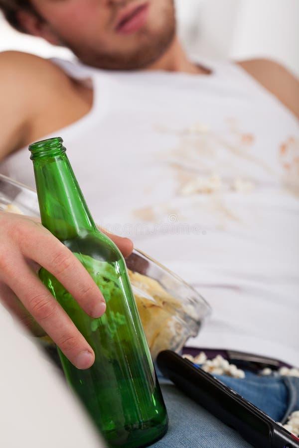 Empty beer bottle closeup stock photo