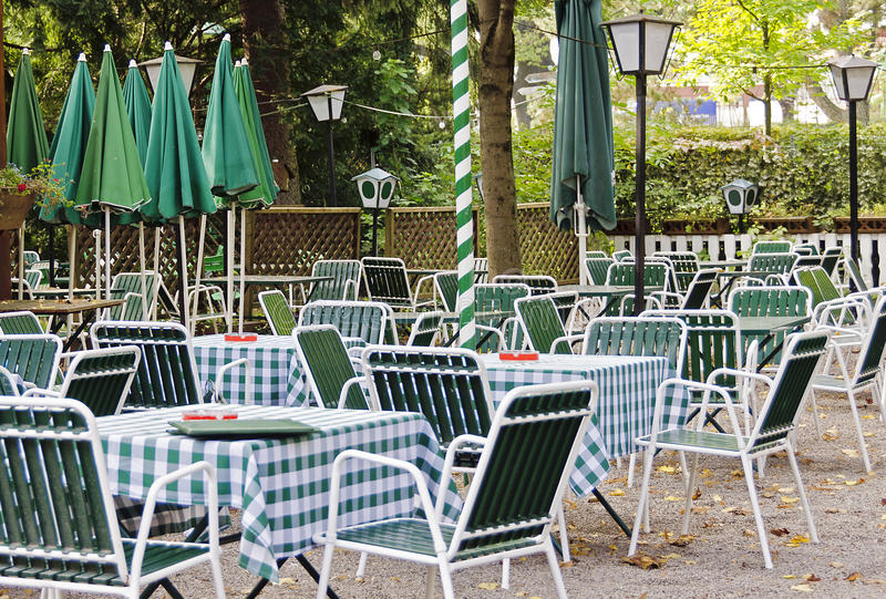 Empty beer garden in green and white. Colors, Vienna, Austria royalty free stock photography