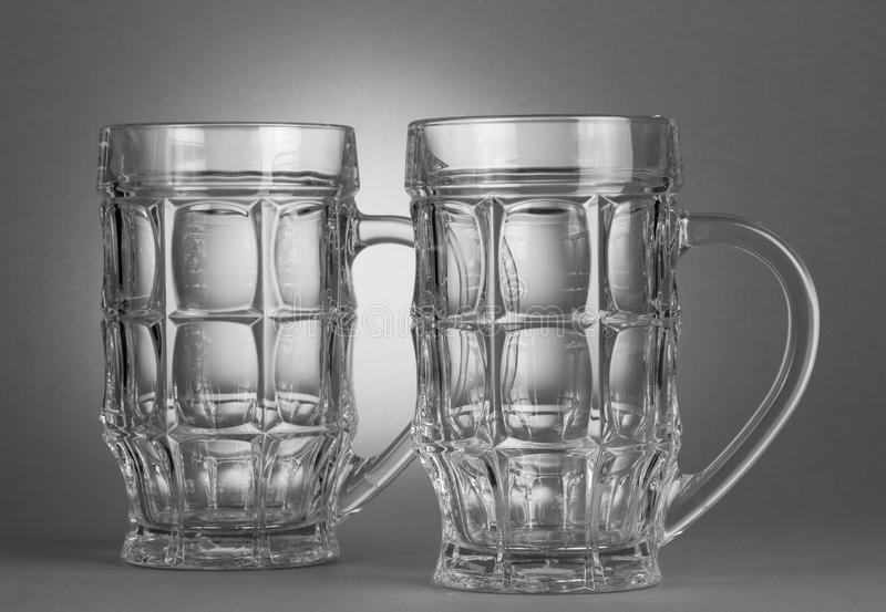 Empty beer glasses. The empty beer glasses on grey background royalty free stock images