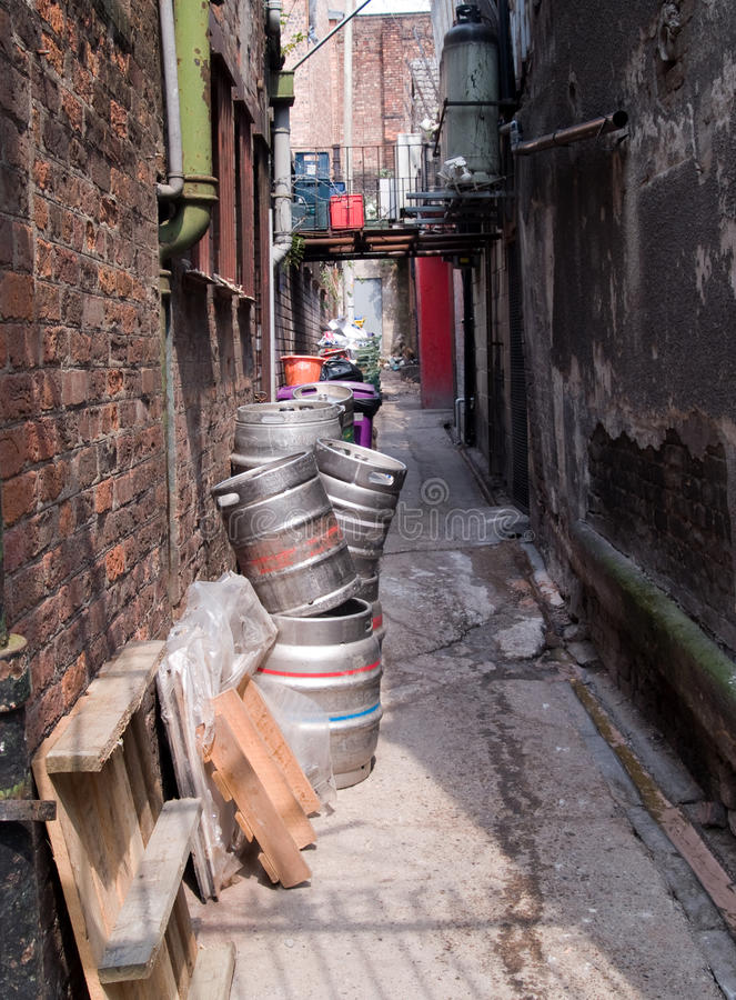 Empty beer kegs. Awaiting collection in a narrow back alley behind licensed premises in Manchester city centre stock photography