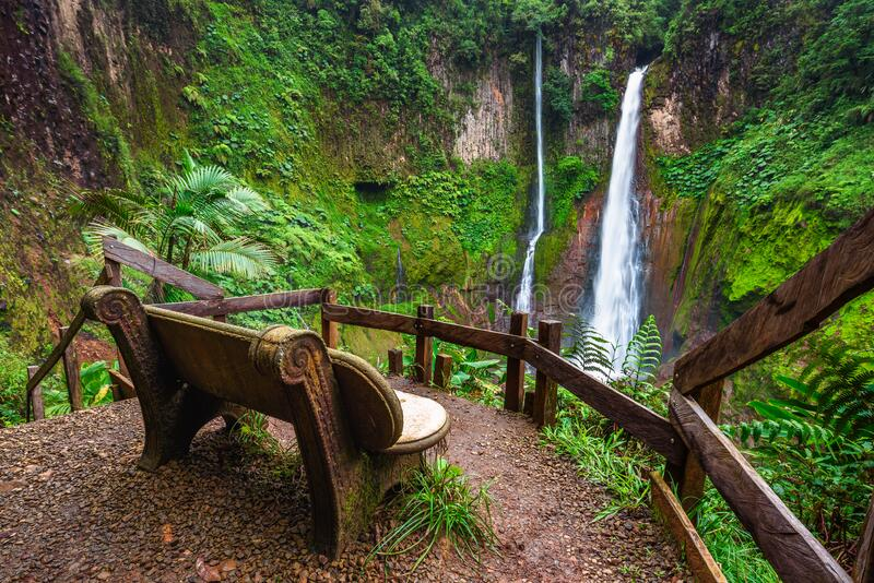 Empty bench at the Catarata del Toro waterfall in Costa Rica stock photography