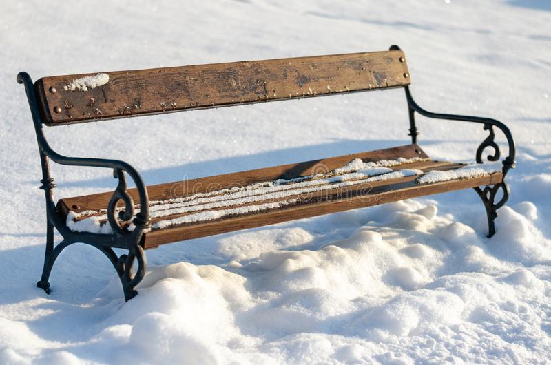Empty bench icovered with snow royalty free stock photo