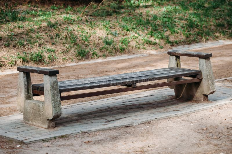 Empty bench made of stone and wood stock image