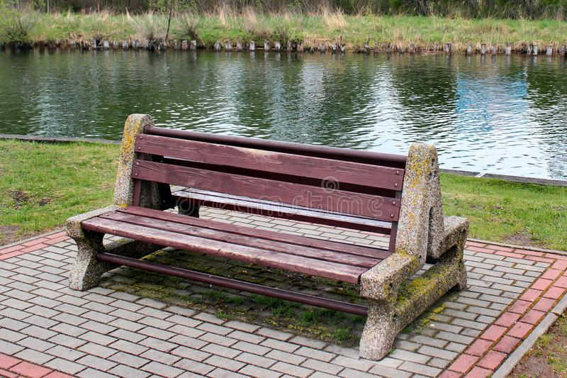 Empty bench near a water canal royalty free stock photography