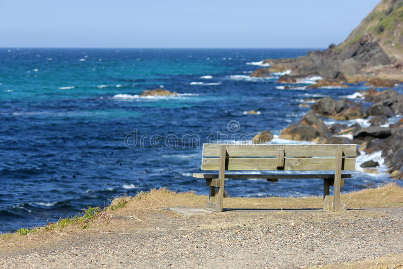 Empty Bench by the Sea. At Forster, New South Wales, Australia stock image
