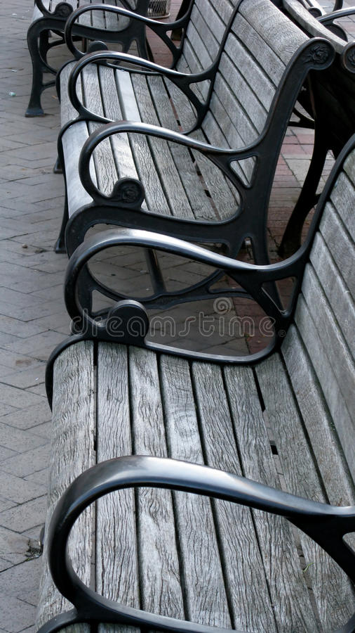 Empty benches. A row of empty park benches royalty free stock image