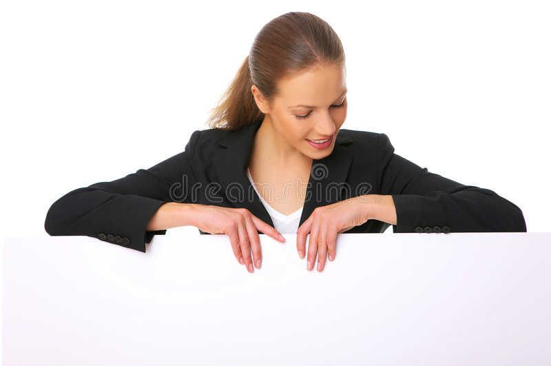 Empty Billboard. Beautiful business woman holding empty white board royalty free stock images