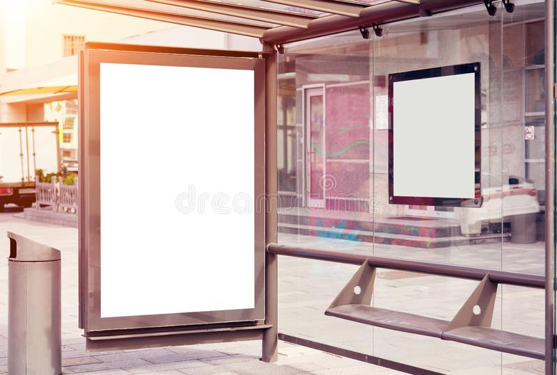 Empty billboard, advertising placeholder on a Moscow public bus stop, truck behind near house, mockup of a blank white poster. stock images