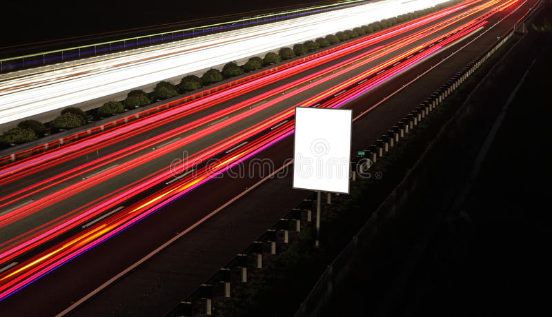 Empty billboards in the highway at night stock photos