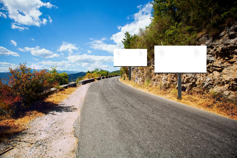 Empty billboards on side of road royalty free stock images